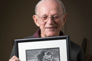 New Zealand's oldest athletics coach Arch Jelley with a photo of Sir John Walker Olympic. Photo / Greg Bowker