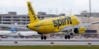 A Spirit Airlines plane landing at Fort Lauderdale Airport