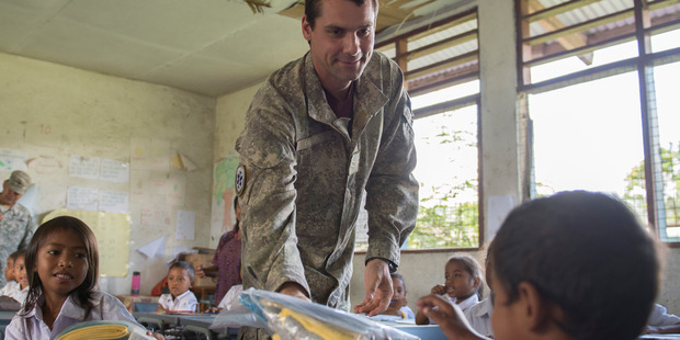 Cpl. Derepa with students in Timor-Leste. Photo / Supplied