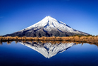 Mt Taranaki provides a majestic backdrop. Photo / Getty Images