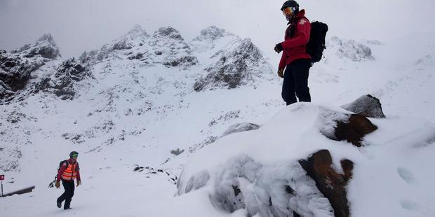 Ski Patrol members on the upper slopes of Whakapapa Ski Area on Mt Ruapehu. Photo / Alan Gibson