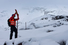 Ski Patrol member Aravinda Hamilton on the upper slopes of Whakapapa Ski Area on Mt Ruapehu today as he checks the safety of the facilities. Photo / Alan Gibson