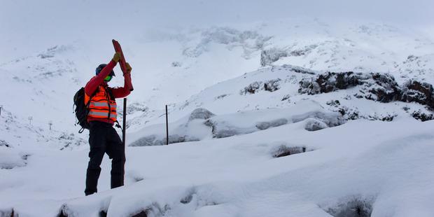 Loading Ski Patrol member Aravinda Hamilton on the upper slopes of Whakapapa Ski Area on Mt Ruapehu today as he checks the safety of the facilities. Photo / Alan Gibson