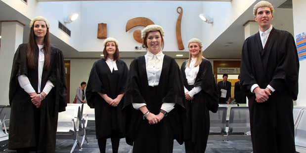 FINAL STEP: Admitted to the bar on Thursday were Petra Allan, left, Nicole Slight, Caroline McHardy, Nick Robertson. and Sophie Nevill (front). PHOTO/STUART MUNRO