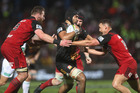 Taleni Seu of the Chiefs fends away Israel Dagg and Kieran Read of the Crusaders during the round 15 Super Rugby match between the Chiefs and the Crusaders. Photo / Getty Images