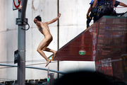 Krit McClean missed the emergency air bag when he jumped, but remained conscious, police said. Photo / AP