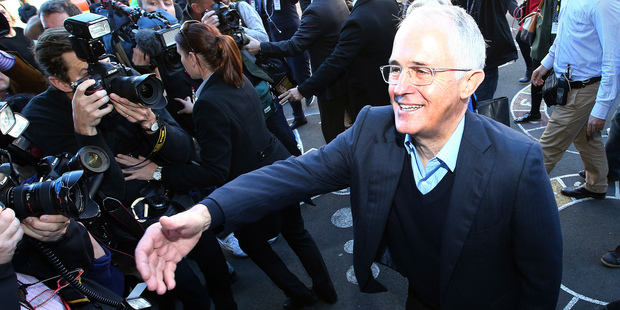 Australian Prime Minister Malcolm Turnbull greets supporters as he leaves a polling station. Photo / AP
