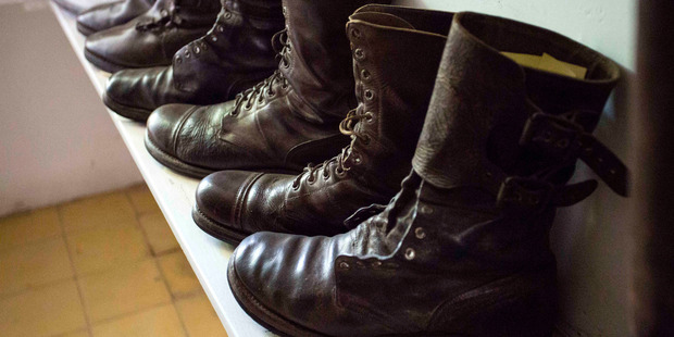 Boots once worn by Ernest Hemingway stand lined up in a dressing room at Finca Vigia. Photo / AP
