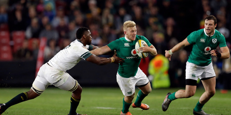 Ireland's Stuart Olding, center, avoids a tackle from South Africa's Siya Kolisi during their second rugby test match at Ellis Park stadium in Johannesburg, South Africa. Photo / AP.