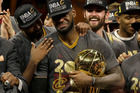 Cleveland Cavaliers forward LeBron James, center, celebrates with teammates after Game 7 of basketball's NBA Finals against the Golden State Warriors. Photo / AP.