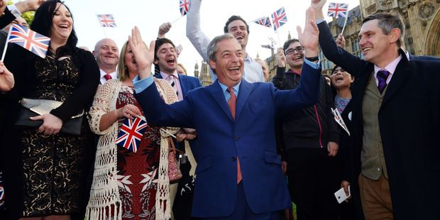 Nigel Farage, the leader of the UK Independence Party celebrates with his supporters in London as people voted to leave. Photo / AP