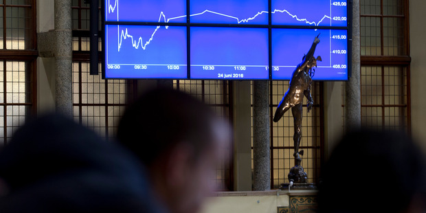 Visitors look at a graph showing the sharp fall of the AEX index following the British Brexit vote at the Euronext Amsterdam Stock Exchange, Netherlands.