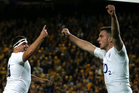 England's Jamie George, left, celebrates with George Ford after he scored a try during their rugby test match against Australia. Photo / AP.
