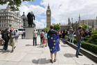 A demonstrator wrapped in the EU flag takes part in a protest opposing Britain's exit from the European Union. Photo / AP
