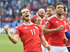 Wales' Gareth Bale, left, celebrates his team's victory after the Euro 2016 round of 16 soccer match between Wales and Northern Ireland. Photo / AP.