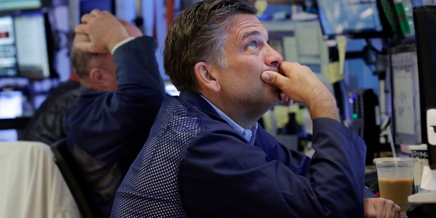 Loading Trader Jeffrey Lucchesi works on the floor of the New York Stock Exchange. File photo / AP
