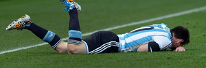 Argentina's Lionel Messi lays on the pitch after being fouled. Photo / Getty Images.