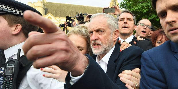 Jeremy Corbyn was defiant as he arrived to talk to supporters in Parliament Square outside the Houses of Parliament in London yesterday. Photo / AP