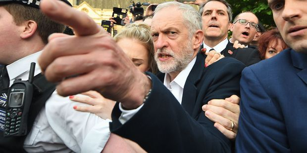 Labour leader Jeremy Corbyn Corbyn has been hit by more than 50 resignations of front bench MPs. Photo / AP