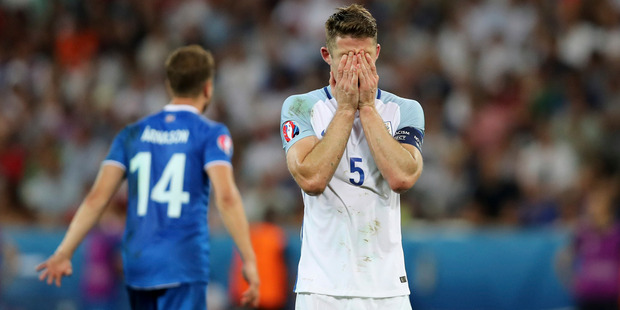 England's Gary Cahill covers his face during the Euro 2016 round of 16 soccer match between England and Iceland. Photo / AP.