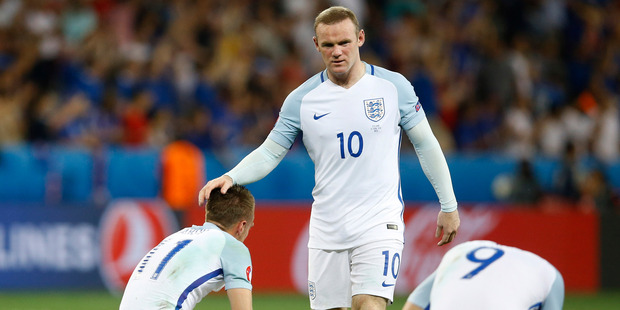 England's Wayne Rooney comforts his teammates at the end of the during the Euro 2016 round of 16 football match between England and Iceland. Photo / AP.