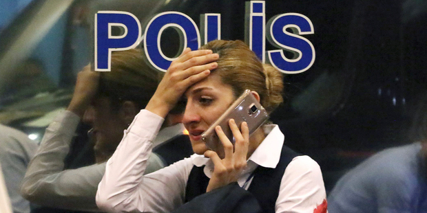 A woman reacts outside Istanbul's Ataturk airport. Photo / AP