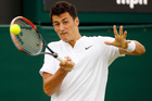 Bernard Tomic of Australia returns to Fernando Verdasco of Spain during their men's singles match on day three of the Wimbledon Tennis Championships. Photo / AP.