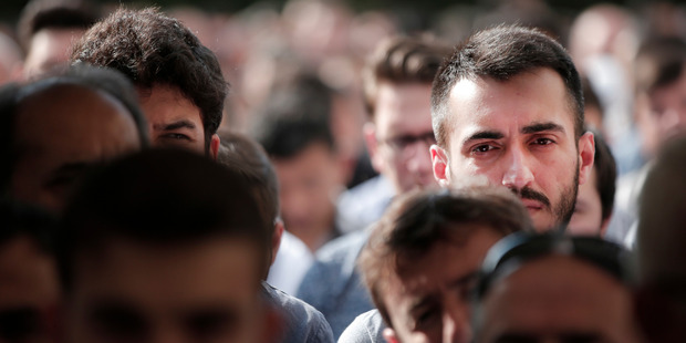 Mourners gather for the funeral of Muhammed Eymen Demirci, killed Tuesday at the blasts in Istanbul's Ataturk airport. Photo / AP