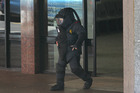A member of the Army bomb squad. Police cordoned off Nicol Jewellers, where the bomb was found, and evacuated the two shops on either side. Photo / Brett Phibbs