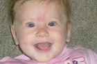 Two-year-old Emily Saunders was swept away in the flooded Poerua River near Greymouth. Photo / Facebook