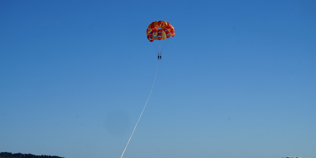 The only way, if temporarily, is up with Flying Kiwi Parasail.