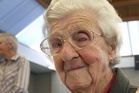 A GOOD LIFE: Esther Booth, thought to be the oldest person in Wairarapa, died on Thursday. Here she is pictured celebrating her 100th   birthday in Masterton, with her congratulatory letter from the Queen. PHOTO/FILE