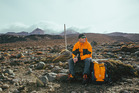 Chris Daniels keeps warm on Ruapehu. Photo / John Bozinov