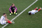 England players Gary Cahill, Joe Hart and Dele Alli react after losing to Iceland. Photo / AP