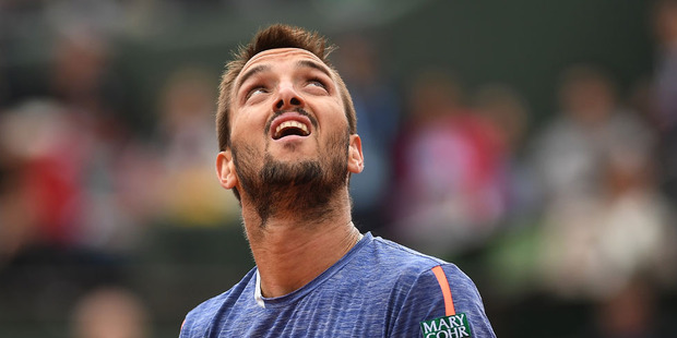 Loading Viktor Troicki let the chair umpire know exactly how angry he was about a key call one point from the end of his five-set loss at Wimbledon overnight. Photo / Getty Images.