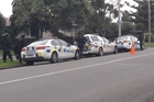 Police on the scene in the Cloverlea area of Palmerston North after the driver of a car fled. Picture / Alecia Rousseau