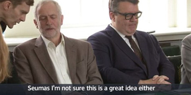 Loading Jeremy Corbyn was caught on camera beckoning over close aide Seumas Milne and voiced reservations about the spectacularly awkward photo op.
