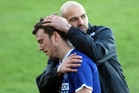 TAKING STOCK: Rovers assistant coach Chris Greatholder consoles a distraught English import, Rob Pearson, after their Chatham Cup exit last Sunday in Napier. PHOTO/Paul Taylor
