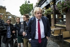 Media chase Boris Johnson for comment after his