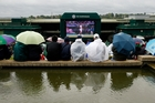 Imagine a future where rain could be diverted from Wimbledon. Photo / AP