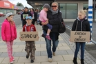 Ginny Laws and her four children lead the march for Moko down High St yesterday morning. Photo / Christine McKay