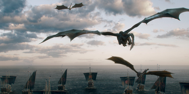 Daenerys' dragons fly above her fleet of ships headed for Westeros.
