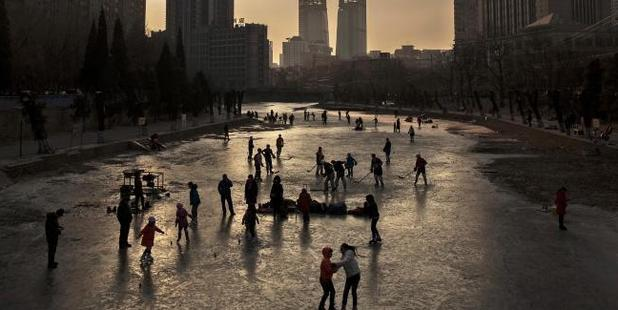 Skaters exercise and play ice hockey on a frozen canal in Beijing. Photo / Getty Images