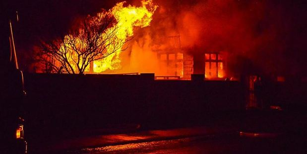 Fire engulfs part of a house in Severn St, Mosgiel. Photo: Supplied / Otago Daily Times