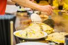 Cooking Hiroshima Okonomiyaki. Photo / iStock