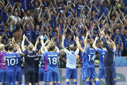 Iceland players celebrate with their supporters at the end of the Euro 2016 round of 16 match between England and Iceland. Photo / AP
