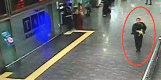 A second suicide bomber can be seen making his way through the terminal with what appears to be a gun.