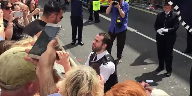 Loading Heartwarming footage has shown the moment a policeman proposed to his boyfriend at London's Pride parade. Photo / YouTube