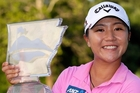 Lydia Ko displays the trophy after winning the Walmart NW Arkansas Championship. Photo / Getty
