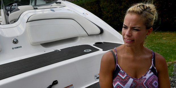 Lauren Conner with the boat from which she fell. Photo / Washington Post